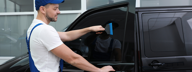 Automotive window film tinting service
